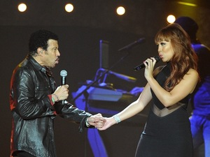 Lionel Richie and Rebecca Ferguson perform at O2 Arena, London.
