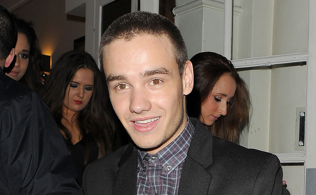 Liam Payne from boyband One Direction, performs magic tricks with some friends outside Funky Buddah nightclub. London, England - 26.10.12 Mandatory Credit: Will Alexander/WENN.com