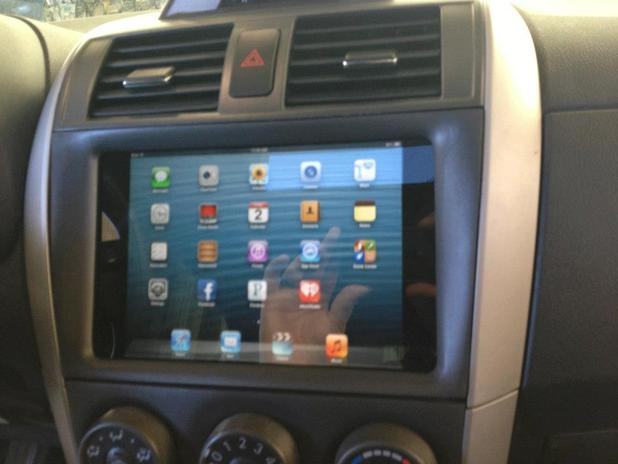 Pictures of 'Soundwaves of Tampa' installing the iPad Mini into a car