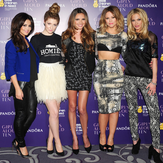 Cheryl Cole, Nicola Roberts, Nadine Coyle, Kimberley Walsh and Sarah Harding of girl band Girls Aloud at a press conference at the Corinthian Hotel in London to announce that they will reunite for a tour next year.