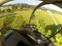 Helicopter pilot rescues a boy's toy plane which had got stuck in a tree.