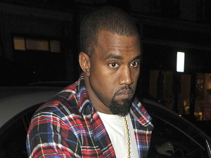 Kanye West trips over a kerb and quickly recovers his footing when he arrives at Hakkasan restaurant London, England