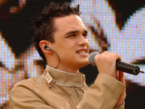Singer Gareth Gates performing on stage during the 95.8 Capital Radio Party in the Park, in Hyde Park, London in aid of The Prince's Trust. (2002)