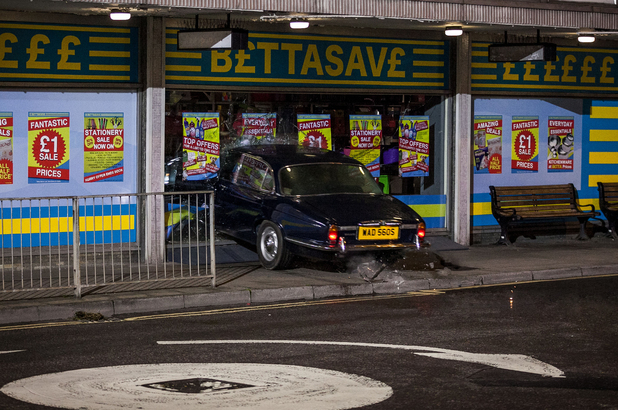 Joey and a drunk Lauren lose control of the car and they crash into a shop front.