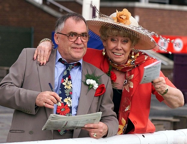 Coronation Street stars Bill Tarmey and Liz Dawn (Jack and Vera Duckworth) enjoy a day out with other cast members at Haydock Racecourse in Merseyside, where they filmed an episode of the show. The special episode will be screened on 8 August 1999.