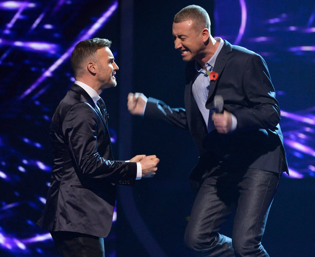 The X Factor Results Show: Christopher jumps for joy.