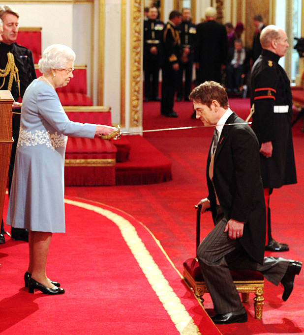 Actor Kenneth Branagh receives a knighthood from Queen Elizabeth II at an Investiture Ceremony, at Buckingham Palace in central London