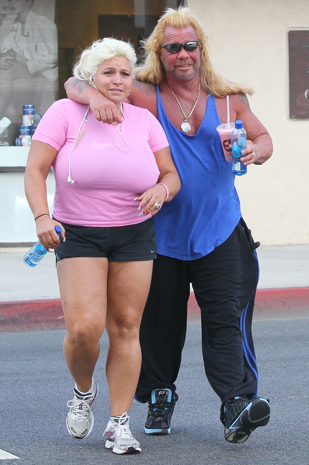 Duane Chapman aka Dog The Bounty Hunter, along with his wife Beth Smith exits a tanning salon in West Hollywood