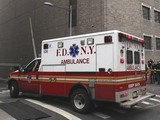 In this Wednesday, Oct. 31, 2012 file photo, an ambulance departs Bellevue Hospital in New York where patients were being evacuated.