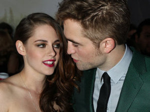 "Kristen Stewart, left, and Robert Pattinson attend the world premiere of ""The Twilight Saga: Breaking Dawn Part II"" at the Nokia Theatre on Monday, Nov. 12, 2012, in Los Angeles. (Photo by Matt Sayles/Invision/AP)"