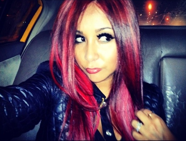 Jersey Shore star Nicole 'Snooki' Polizzi shows off her new red hair.