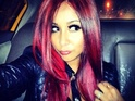 "The Jersey Shore star describes her new do as a ""fireball"" and ""poison ivy""."