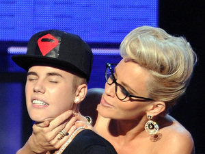 Justin Bieber and Jenny McCarthy at the American Music Awards
