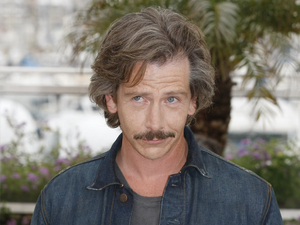 Actor Ben Mendelsohn poses during a photo call for Killing Them Softly at the 65th international film festival, in Cannes, southern France, Tuesday, May 22, 2012.