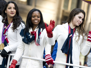 US gymastics team members, from right, McKayla Maroney, Gabby Douglas and Aly Raisman ride a float in the Macy&#39;s Thanksgiving Day Parade 