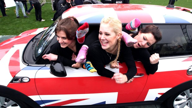 Linsi Ludlam, Helen Statnic and Katie Fitzpatrick from Eastbourne as the record for most people crammed in a modern MINI is 28 using the MINI Hatch is achieved by Dani Maynard and her team in 18 minutes, at Potters Field, London