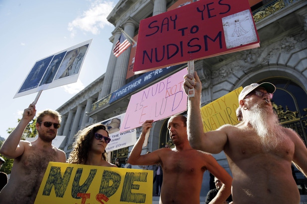 Demonstrators gather at a protest against a proposed nudity ban outside of City Hall in San Francisco.