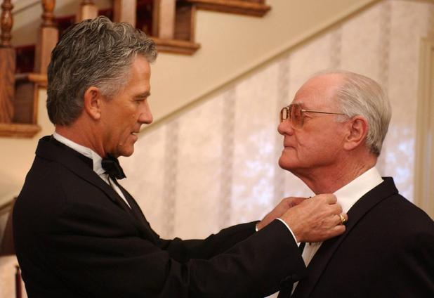 Patrick Duffy straightens Larry's tie as they film a Dallas reunion show.