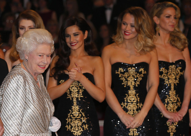 Britain's Queen Elizabeth walks past Girls Aloud as she arrives to greet the performers after the Royal Variety Performance at the Royal Albert Hall in London. Picture date: Monday November 19, 2012. See PA story ROYAL Variety. Photo credit should read: Andrew Winning/Reuters/PA Wire