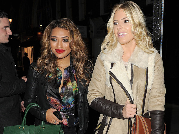 Vanessa White and Mollie King from girl group 'The Saturdays' leave the opening of new store 'Supertrash'. London, England