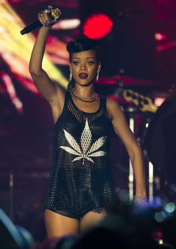 Barbadian singer Rihanna performs during the fifth stop of her 777 worldwide tour at the E-Werk club in Berlin