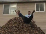 Group of friends jump into world's biggest leaf pile - video still