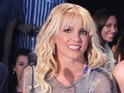Britney Spears is accused of sabotaging contestant Arin Ray by his godmother.