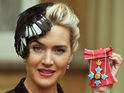Actress awarded CBE from Queen, wears feathered fascinator.