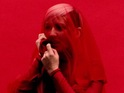 The singer is covered in a red veil in her latest visual.