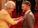 The Take That man and X Factor judge is honoured by Her Majesty.