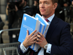 Chris Bryant MP carries copies of Lord Justice Leveson&#39;s Report from the Inquiry into the Culture, Practices and Ethics of the Press, at the QEII Conference Centre, in central London.