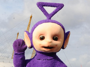 Po (left) and Tinky Winky of the Teletubbies close to the O2 Arena, London.