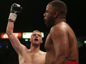 Andrew Flintoff celebrates his victory over Richard Dawson (right) during the International Heavyweight Contest at the Manchester Arena, Manchester.