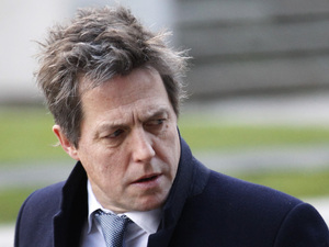 British actor Hugh Grant, who testified to the Leveson Inquiry, arrives at the Queen Elizabeth II Conference Centre in London where Lord Justice Brian Leveson is to release his report