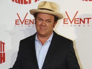 John C. Reilly poses for photos as he arrives for a screening of the animated Disney feature, Wreck-It Ralph in Sydney.
