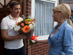 8016: Stella refuses a bouquet of flowers from Karl but he persists, asking her out for dinner
