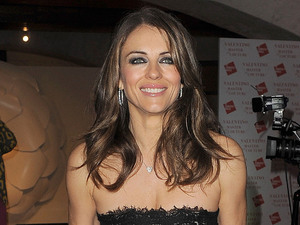 Elizabeth Hurley. Valentino: Master of Couture - Private View - Departures. London, England