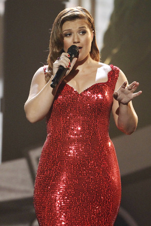 Kelly Clarkson performs at the 39th Annual American Music Awards on Sunday, Nov. 20, 2011 in Los Angeles. (AP Photo/Matt Sayles)