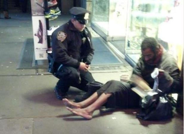Police officer gives shoes to homeless man