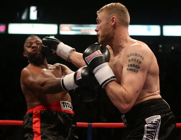 Andrew Flintoff (right) and Richard Dawson in action during the International Heavyweight Contest at the Manchester Arena, Manchester.