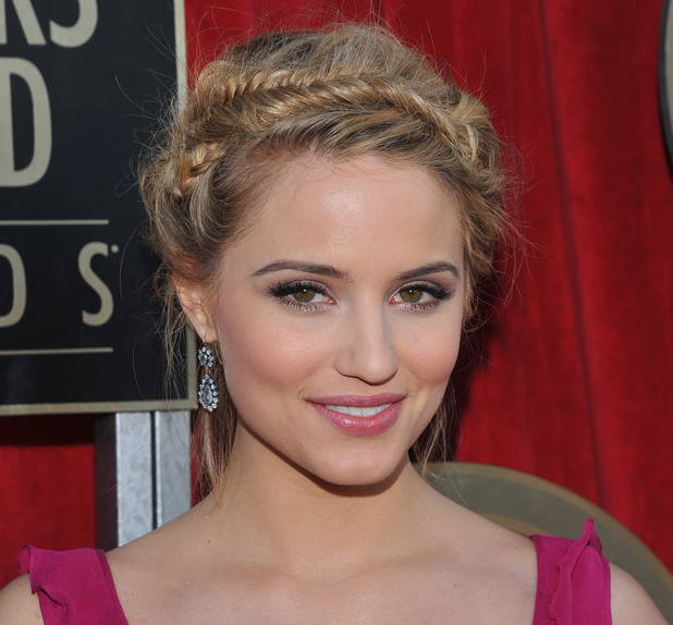 Dianna Agron arrives on the red carpet at the 18th Annual Screen Actors Guild Awards on Sunday Jan. 29, 2012 in Los Angeles.