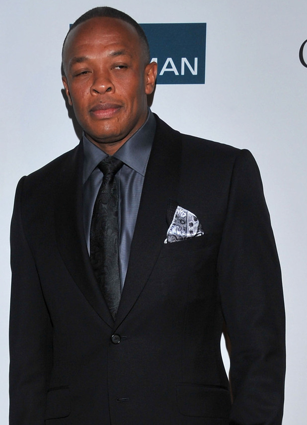 Dr. Dre arrives at the Pre-GRAMMY Gala & Salute to Industry Icons with Clive Davis honoring Richard Branson, Saturday, Feb. 11, 2012, in Beverly Hills, Calif.