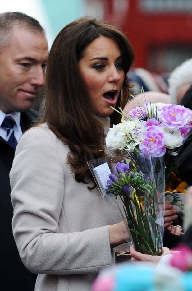The Duchess of Cambridge wears a tartan coat