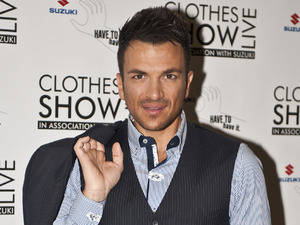 Peter Andre posing for press on the opening day of The Clothes Shows Live 2012 