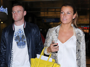 Wayne Rooney and Coleen Rooney arrive at LAX on a flight from London Los Angeles, California - 26.06.12