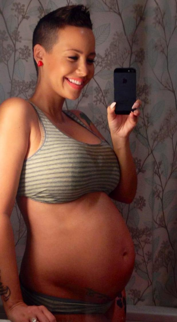 Amber Rose shows off her baby bump