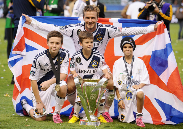 LA Galaxy&#39;s David Beckham poses his sons (left to right) Brooklyn, Cruz and Romeo after winning the MLS Cup Final at the Home Depot Center, Los Angeles, USA.