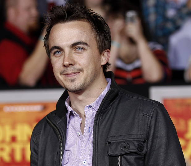 "Frankie Muniz arrives at the premiere of ""John Carter"" in Los Angeles, Wednesday, Feb. 22, 2012."
