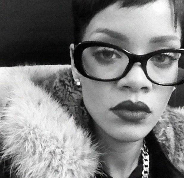 Rihanna poses in glasses and Adidas clothing