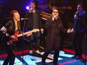 Bono, Chris Martin, Gary Barlow, Brandon Flowers perform at War Child gig in 2009.